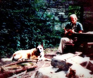 Bjorkman with his dog, and his guitar, and his cigarettes. NH rock quarry, a long long time ago...